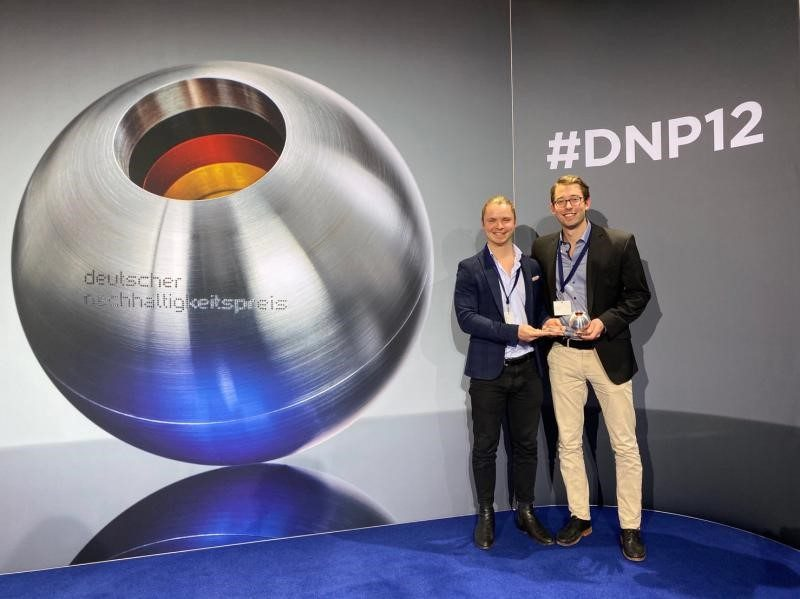 Philipp and Lukas holding award